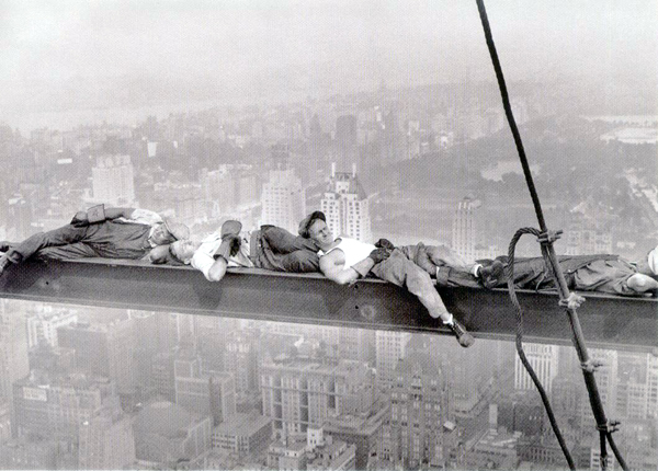 Iron Workers Sitting On Beam