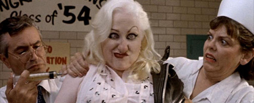 Mona 'Hatchet-Face' Malnorowski - Kim McGuire