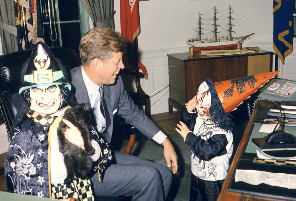 President Kennedy w a couple of witches